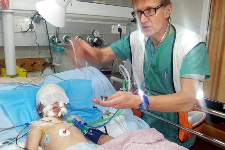 http://www.theoslotimes.com/wp-content/uploads/2014/07/Dr-Mads-Gilbert-treating-a-wounded-child-in-Shifa-Hospital.jpg