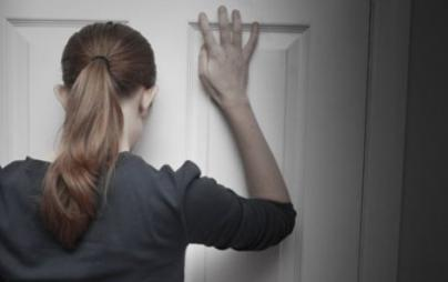 woman-behind-closed-door
