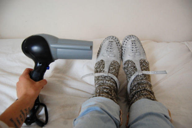 Save your feet by breaking in your shoes with a thick pair of socks (or two) and apply heat with a hair dryer on low. Repeat the process with another layer of socks if additional stretching is needed.