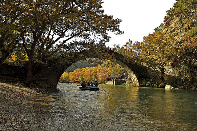 voidomatis stone bridge at sunset in autumn