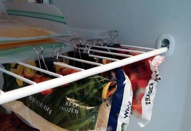 Do bags of frozen veggies spill out of your freezer every time you open it? The solution is binder clips.