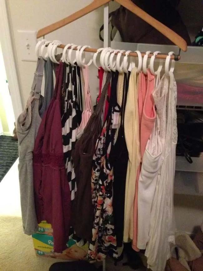 Tank tops don't require a lot of space. Here's how to store a bunch on one hanger.