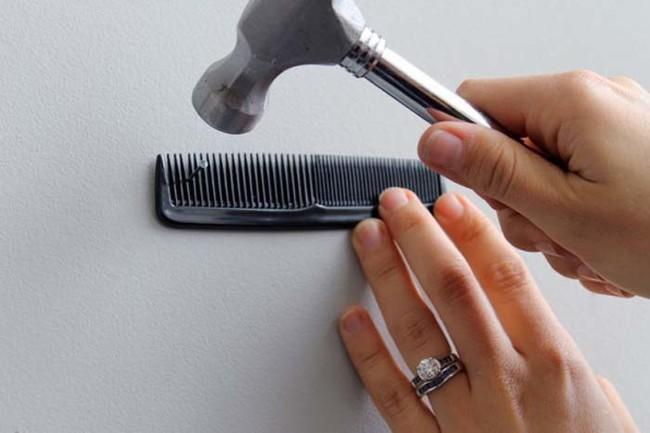 Don't hurt your thumbs when hammering nails into the wall. Hold them in place with a comb.