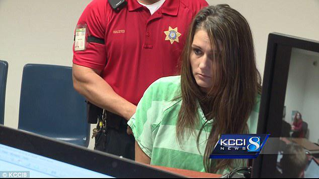 Macke is pictured above during her first court appearance on Thursday, when she was ordered held in lieu of $9,000 bail