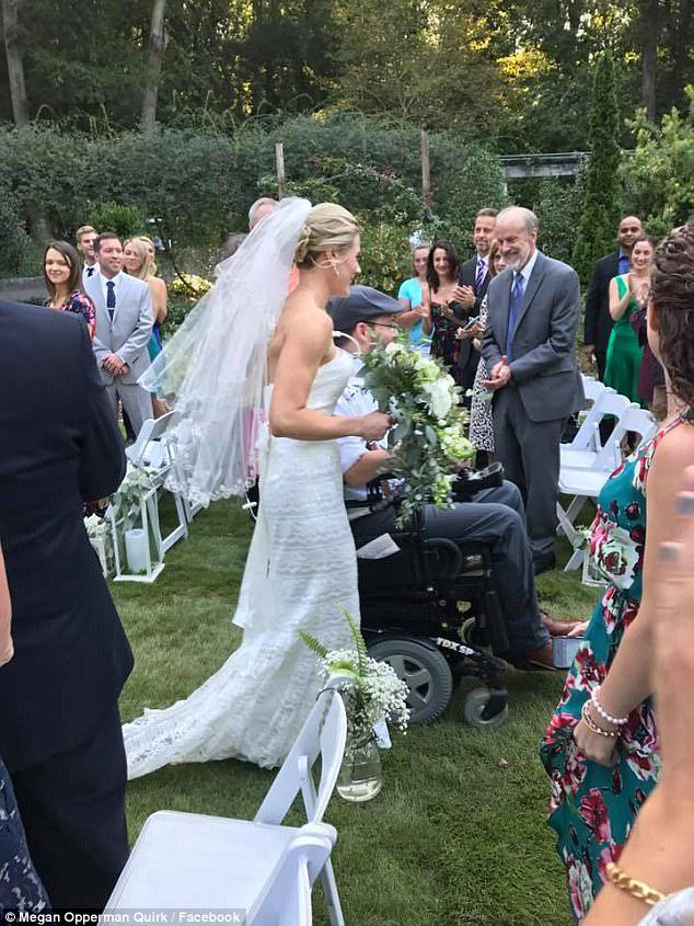 The couple head down the aisle on their wedding day, nine months after Brett was paralyzed