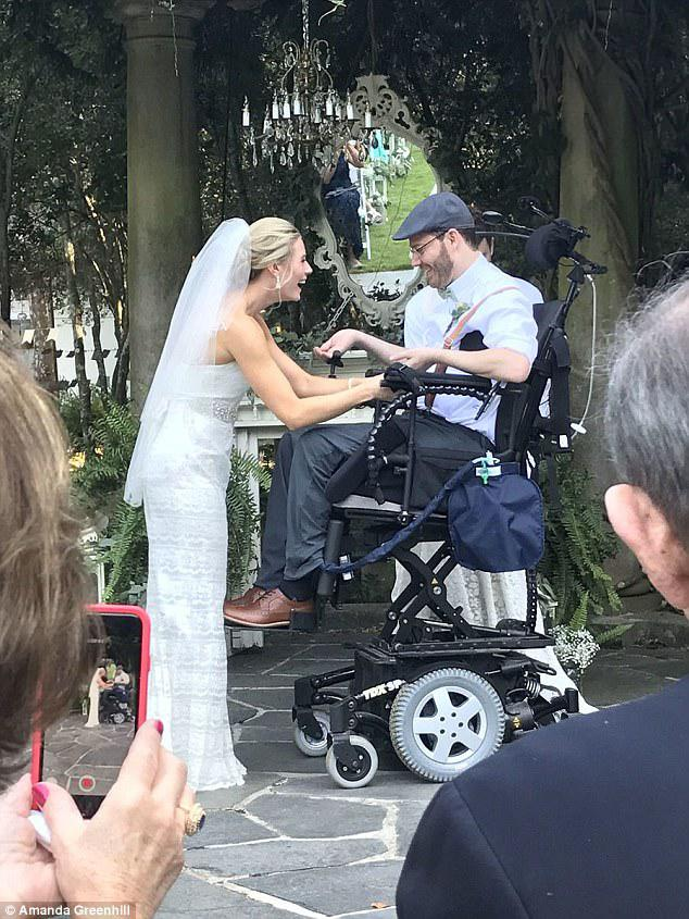 Meg and Brett are pictured at the altar during their wedding day on September 9. Brett was paralyzed during their joint bachelor-bachelorette party in December