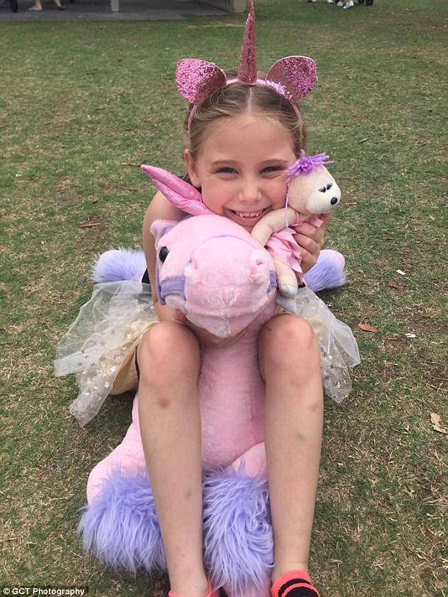 The party came a week after Mia (pictured with a unicorn gifted by a stranger) was left devastated after only two children from her school showed up to her birthday party
