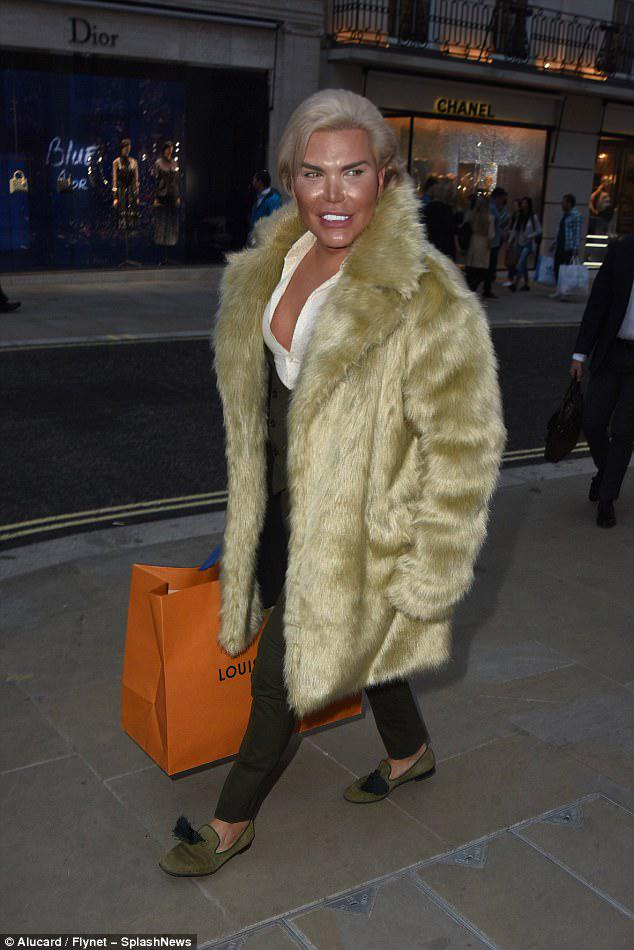 Plastic surgery addict: Rodrigo was clearly dressed to command attention in his fur outerwear, which skimmed his enhanced physique