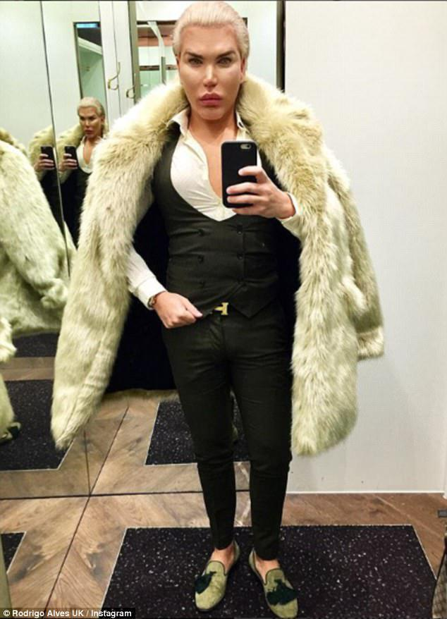 'It is that time of the year': After a few months of posing in barely-there shorts, Rodrigo explained the reason for his bulky coat, as he took to Instagram with a full-length mirror snap