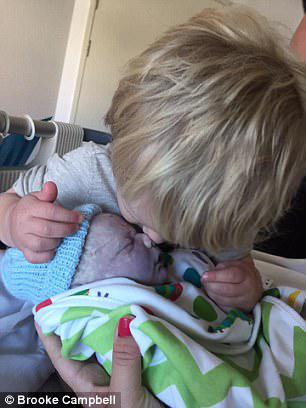 Little Noah planted a kiss on his baby brother