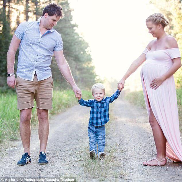The mother - pictured with her husband Elliott, 34, and their son Noah, aged two - while pregnant with Darcy before his tragic stillbirth at 36 weeks