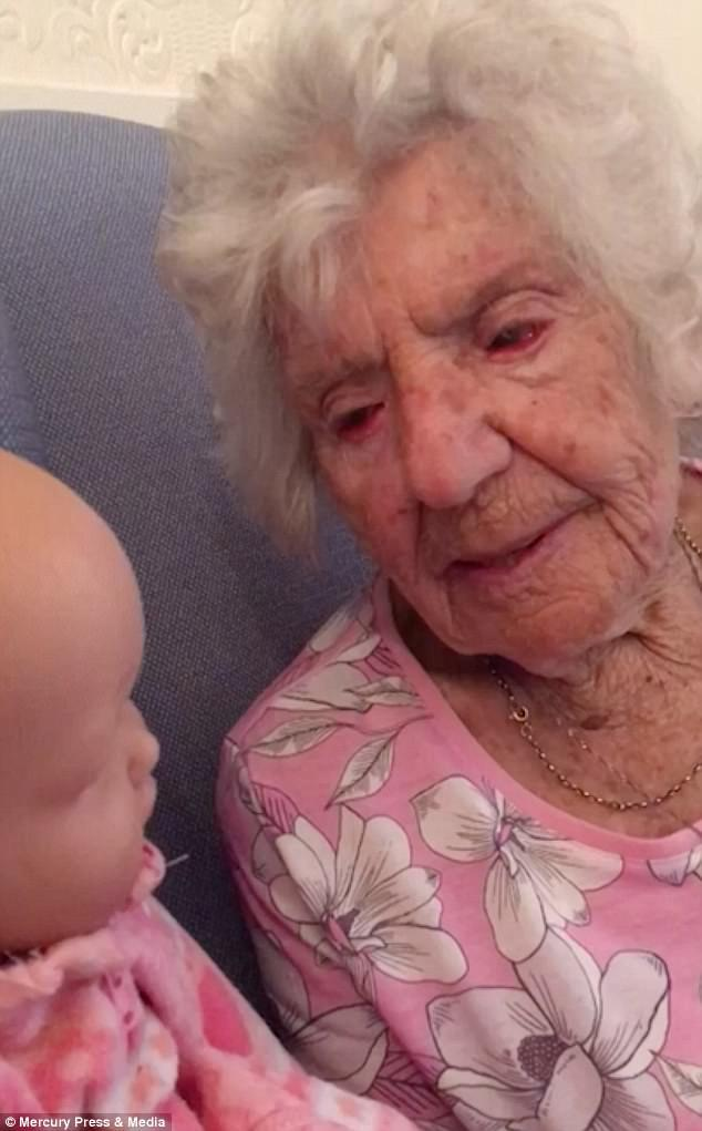 The 94-year-old likes to feed and cuddle her doll, but doesn't change her clothes