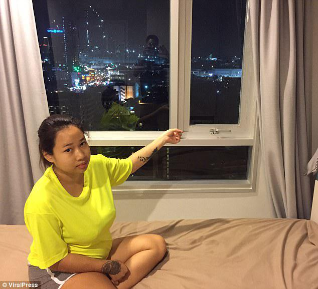 Guilt: Netchanok Nokyungtong, 20, shows police where she threw out her newborn baby boy after her married boyfriend left her to go back to his family