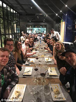 The grateful employees from Poole, Dorset are pictured enjoying dinner on their boss in the Spanish capital last week