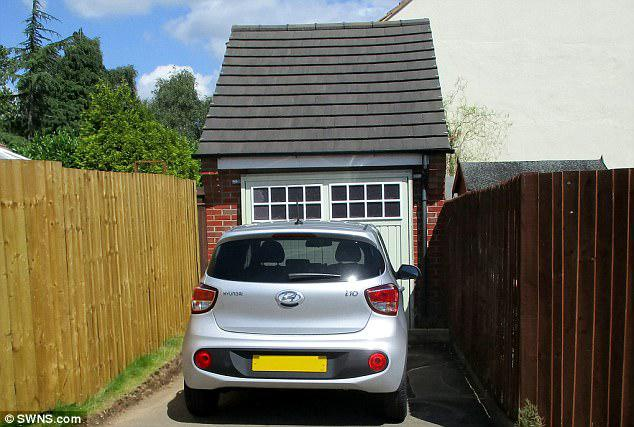 The couple were convicted in their absence at Leicester Magistrates Court after failing to make plea. Pictured: A car in front of the fake garage