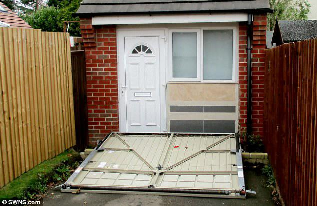 Councillor Sheila Scott, the council's cabinet member for planning, said:'If you breach planning regulations and ignore us we will not just go away'. Pictured: A close-up view of the fake garage