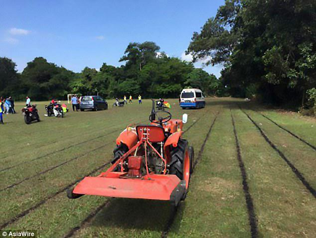 A tractor, pictured, is believed to have been pulling the lawnmower when it malfunctioned, sending the blades flying, in the field where  14-year-old Nur Afini Roslan was playing