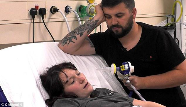 Ben dutifully stands by Amy's side as she goes through labour holding the gas and air pump in his hand as she breathes through contractions