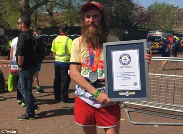 Rob Pope (pictured after finishing the London marathon) broken the Guinness World Record for the fastest male marathon runner in a film character costume