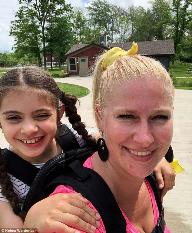 Helma Wardenaar put Maggie Vazquez, 10, in a $300 child carrier and put her on her back through the two-day camping trip