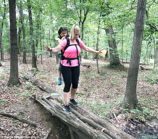 Ms Helma, as her students call her, said carrying Maggie (pictured together) through the May 30 to June 1 camping trip was hard, but the little girl kept her spirits up