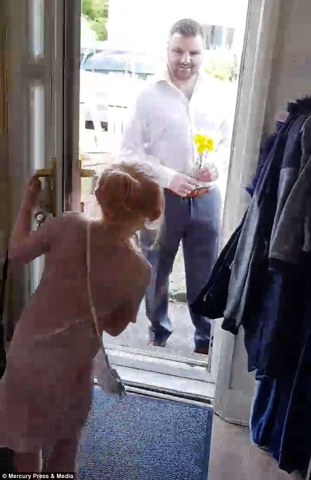 Andy was filmed by Sophie's mother Hayley turning up at the door with a bunch of flowers