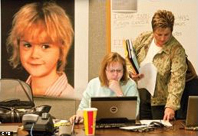 The FBI has been working with local and state authorities on the case since 2009. An undated photo shows an FBI crime analyst discussing evidence with a field agent