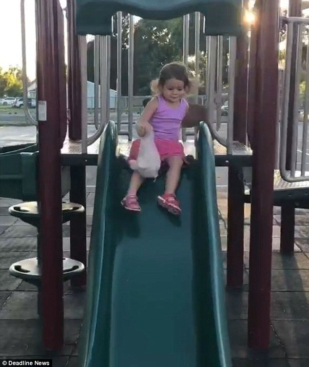 The toddler was filmed slapping the bottom of the slide and stamping her foot on the plastic to encourage Franny to slide down with her