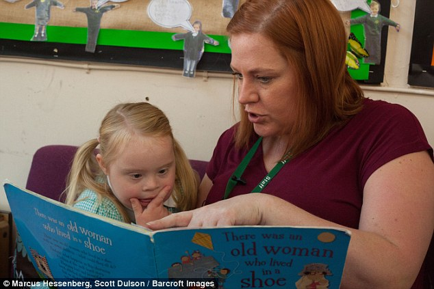 Teacher Charlotte Williams (pictured with Grace) revealed seven-year-old model Grace, is perhaps the most popular girl in her class
