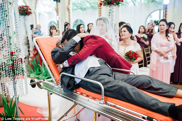 Charlotte's husband Mark Cordova shares a tender moment with her dying father Pedro on their wedding day in Manila in August 2018