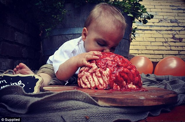 Speaking to FEMAIL, the Melbourne-based mum revealed exactly how she put her gory creation together, as well as how much it cost her (pictured: Alexander with the cake smash)