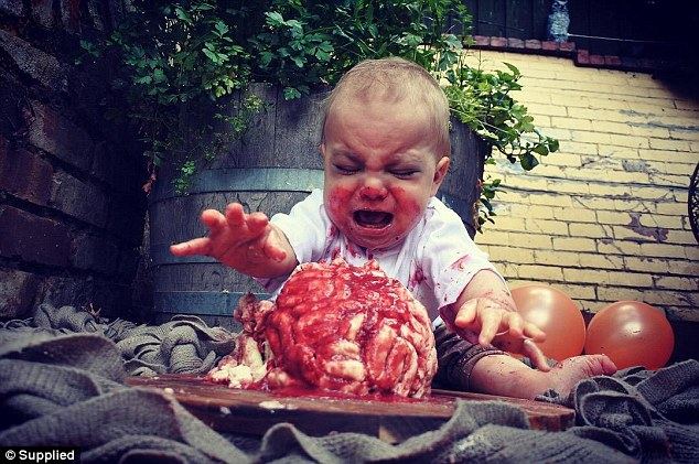 Liz from Melbourne's son, Alexander (pictured), turns one on Halloween, so she decided to theme invitations for his birthday around a zombie cake smash