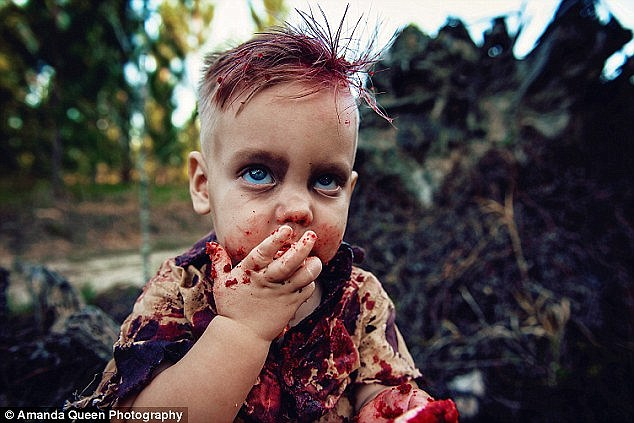 Amy Louise, from Brisbane, was slammed after her son was pictured in a series of gruesome photographs feasting on a bloody 'brains' cake (pictured: baby Phoenix)