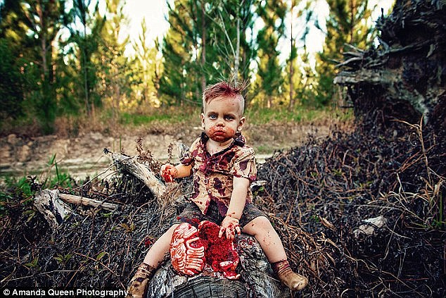 This isn't the first time an Australian mother has themed a cake smash around zombies and gore; Amy Louise also did the same for her son, Phoenix (pictured)