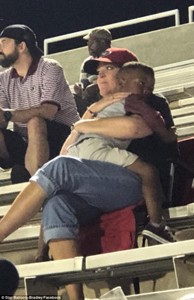 saiah was attending a high school football game in Georgia when he spotted a woman he had never seen before and immediately sat on her lap