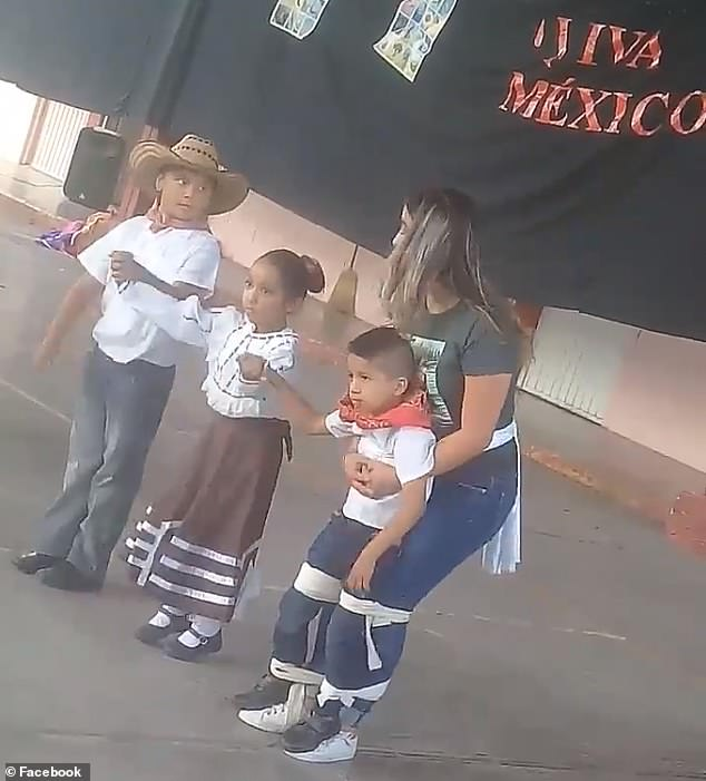 Melissa (right), a first grade teacher at an elementary school in Mexico, made sure a special needs students (front right) was able to participate during a recent school festival