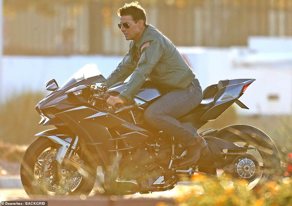 Focused: The handsome movie star, who is also an avid motorcycle rider and pilot, was seen riding the bike around the set on Tuesday