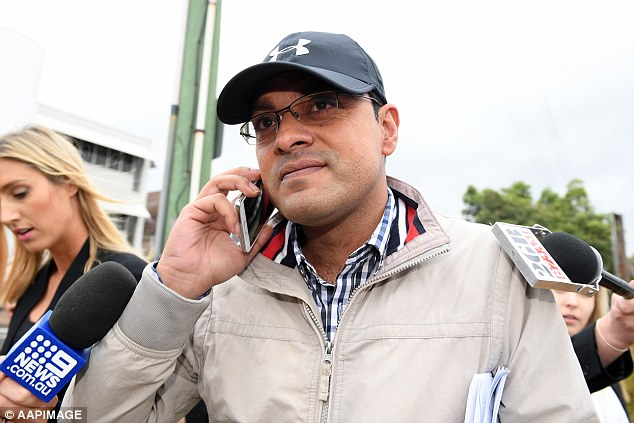 Moud Ul Hasan Nuri, 40, leaves court to a barrage of abuse from angry citizens.