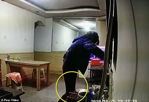 The caretaker's daughter said the kick (circled) in the clip was actually her mother putting on her slippers and not of her hurting the man. The man sustained a broken hip in the incident