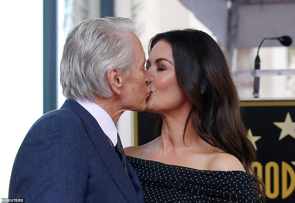 Rite of passage: Michael Douglas, whose illustrious acting career spans almost five decades, gathered his loved ones, including wife Catherine Zeta-Jones and his movie veteran father Kirk, to celebrate the unveiling of his star on the Hollywood Walk of Fame on Tuesday
