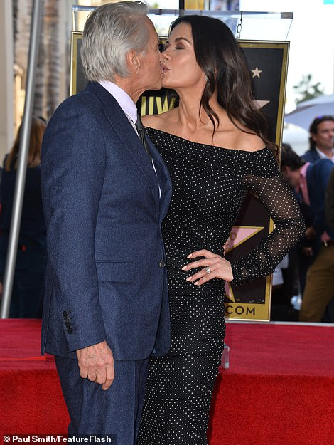 Still smitten: Michael and Catherine, who share son Dylan, 18, and daughter Carys, 15, looked head over heels as they shared a kiss at the event