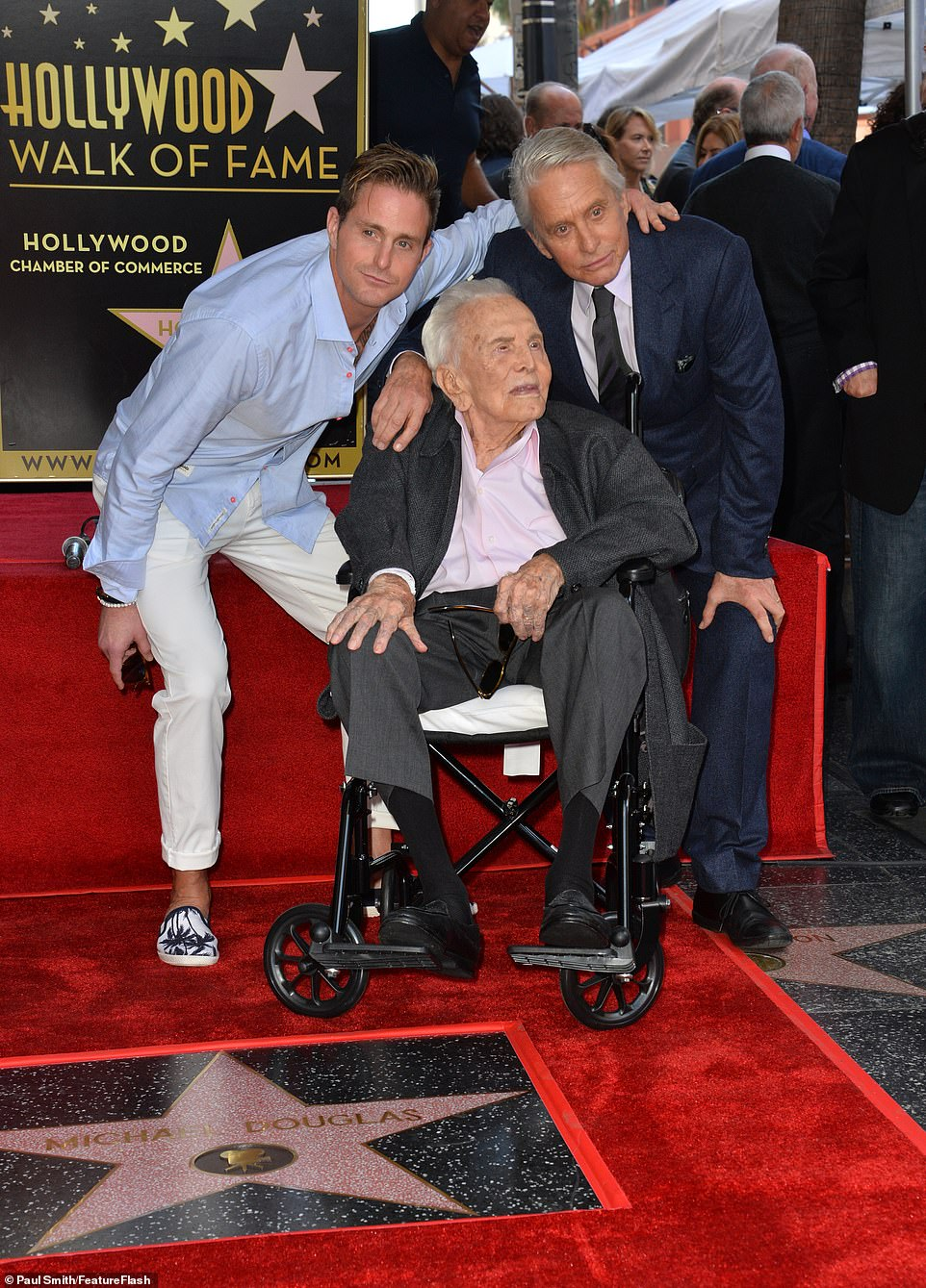 Sharing the day with his loved ones: Cameron put an affectionate arm around his dad as they shared a snap with acting legend Kirk in front of his star