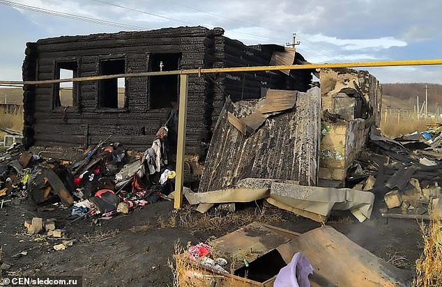 The body of Danil Vorobyev was found lying on top of the twins Sasha and Denis in the ruins of the house (pictured) in the Samara region of south-western Russia