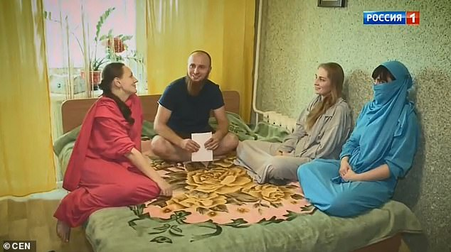 Ivan Sukhov, 34, from the city of Vladimir in Russia's western Vladimir Oblast region, says he dreams of having more wives and at least 50 children. He is pictured with his three 'wives'