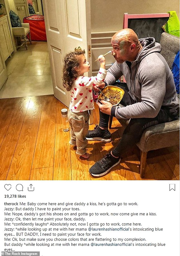 Daddy duty: Dwayne 'The Rock' Johnson, 46, posted a snap to Instagram on Wednesday where he let his daughter Jasmine, two, paint his face before heading off to work