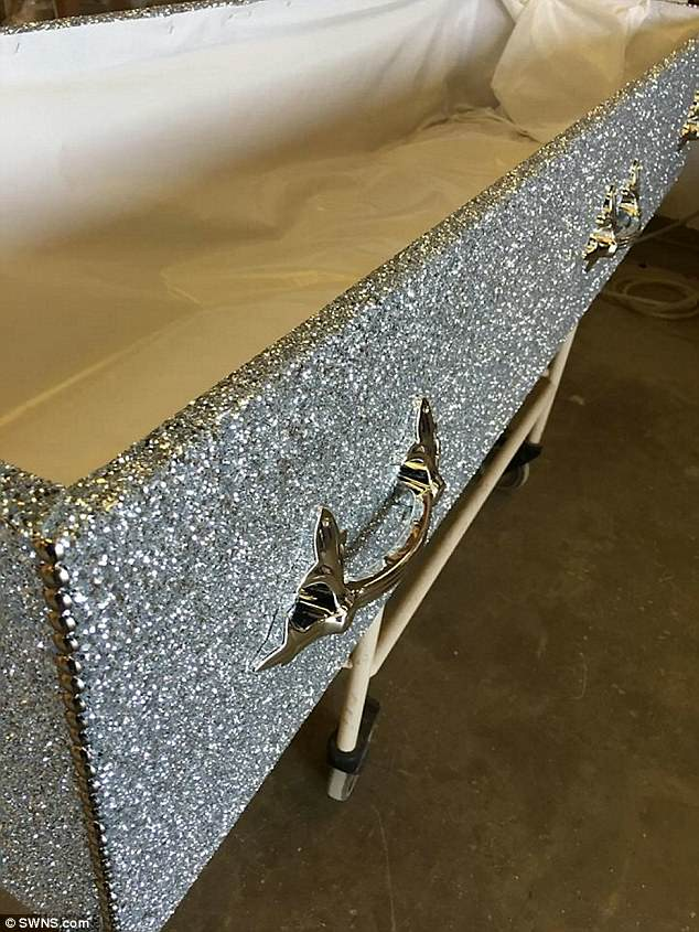 The coffins are purchased from a manufacturer before being bedazzled by the dazzle