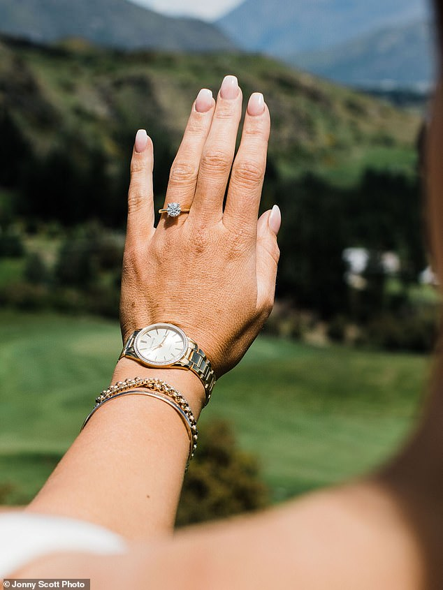 A dazzling 2ct Diamond Solitaire ring from Michael Hill Jeweller's exclusive Southern Star collection caught the light as it was slipped onto Ms Anderson's finger