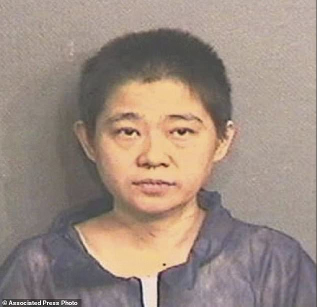 This undated photo provided by the Houston Police shows Lihui Liu, charged with capital murder in the death of her 5-year-old son who prosecutors say was drowned and decapitated. Harris County court records show Liu was being held without bond Sunday, Dec. 2. (Houston Police via AP)