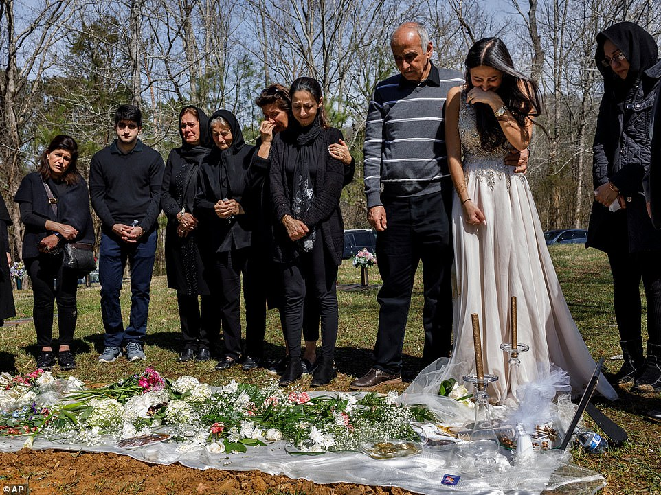 Family members mourn at the grave of Mohammad Sharifi at Harpeth Hills Memory Gardens in Nashville