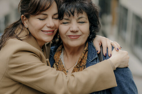 portrait of happy woman hugging her mother OGF00277